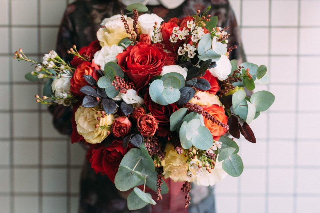 Florist Holding to a bunch of flowers